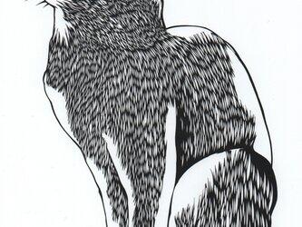 額装済み切り絵原画・見上げる猫の画像