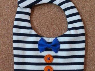 リボンとボタンのスタイ(しましまオレンジ)の画像