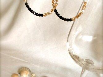 シャンパンゴールドとブラックのルーフピアスの画像