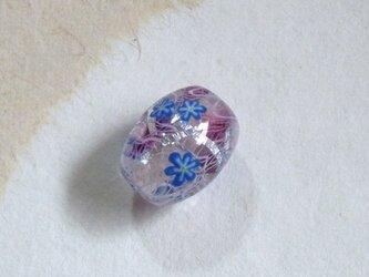 青いお花のとんぼ玉の画像