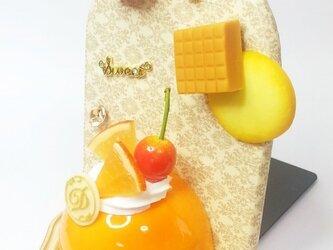 オレンジドームケーキのブックスタンドの画像