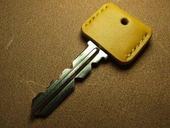 黄色いキーカバー の画像