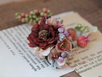 二色の小花の片耳ピアス(フェイク)の画像