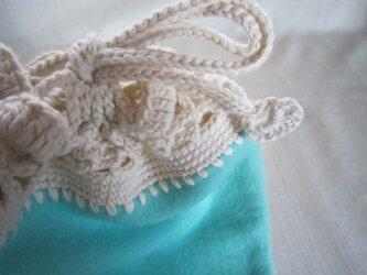 ブルーグリーンのふち編み巾着の画像