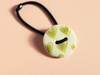 磁器ボタンゴム 丸 ハート ライムの画像