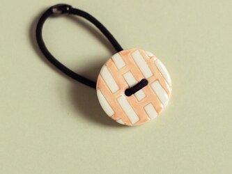 磁器ボタンゴム 丸ミシン ピンクの画像
