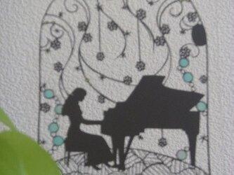 切り絵のスノードームの画像