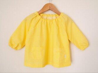 黄色いギンガムチェックのスモック (70〜80cm)の画像