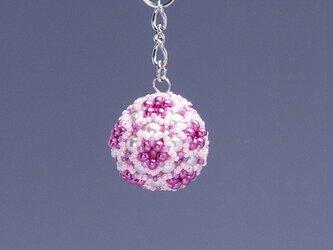 星型の花模様のボールの携帯ストラップ・ピンクの画像