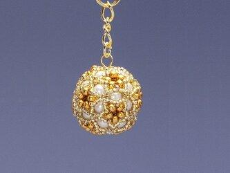 星型の花模様のボールの携帯ストラップ・ゴールドの画像