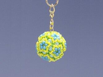星型の花模様のボールの携帯ストラップ・イエローの画像