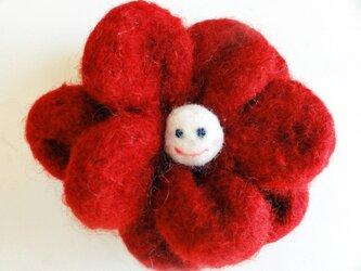 赤い笑顔の花 スマイルコサージュの画像