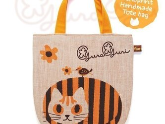 GuraGuri|リネン・ミニトートバッグ|オレンジの丸い猫の画像
