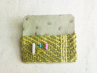 「夜になると1」手織り布・革 ブローチの画像