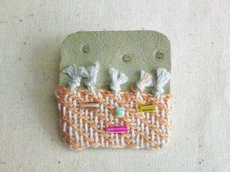 「Face1」手織り布・革 ブローチの画像