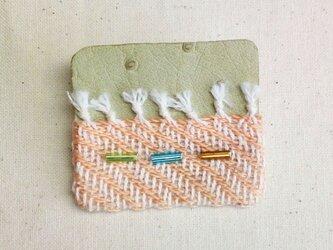 「Orange1」手織り布・革 ブローチの画像