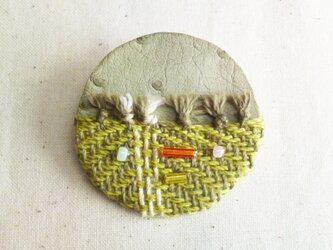 「Face3」手織り布・革 ブローチの画像