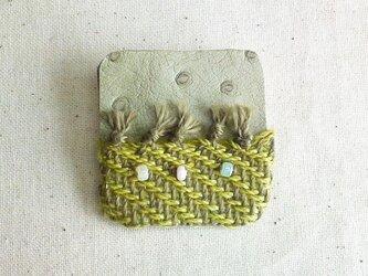 「夜になると7」手織り布・革 ブローチの画像