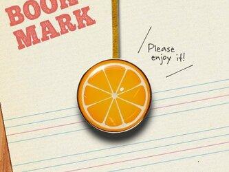「オレンジ柄のクリップ型ブックマーク」no.023の画像