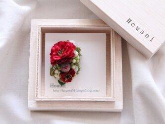 赤いお花の片耳ピアス(フェイク)の画像