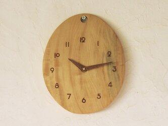 卵の掛け時計  とち材の画像