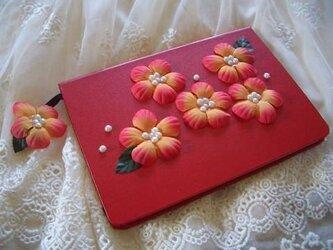 赤いお花のノートの画像