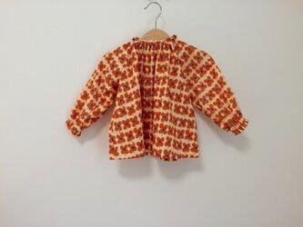 オレンジクローバー柄スモック長袖 サイズ90の画像