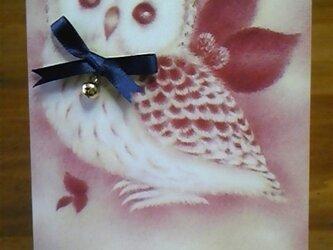 青いリボンと金の鈴のフクロウのポストカードの画像