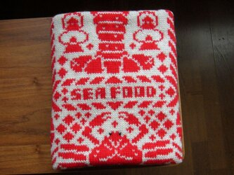 編み込みのひざ掛け シーフード ベージュ×赤の画像