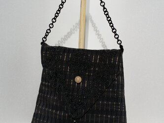 黒モチーフの蓋つきbagの画像