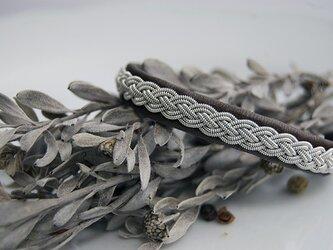 トナカイの革×ピューター糸の4つ編みブレスレット chocolate lover の画像