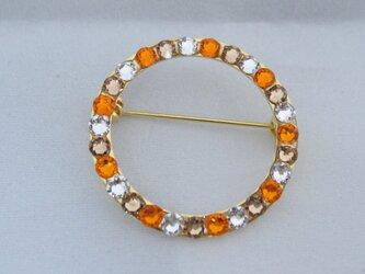 スワロフスキーのリング型ブローチ☆オレンジの画像