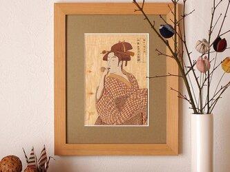 木はり絵「ポッペンを吹く娘」の画像