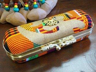 ゴールドチャーム付きハードタイプの印鑑ケース がま口印鑑ケース アフリカン生地 オレンジの画像