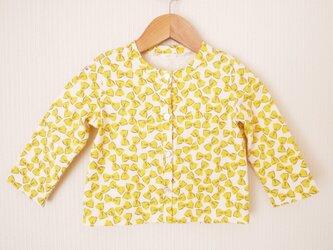 黄色いリボン柄のクルーネックカーディガン (90cm)の画像