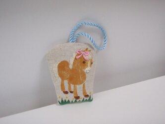 ビスケット色の小さな馬の飾り dの画像