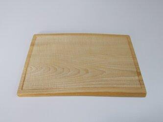 栓の木の手彫りのパン皿の画像