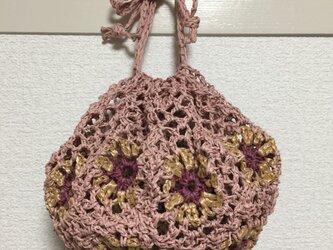 ピンクモチーフの巾着バッグの画像