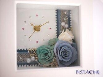 ターコイズブルーのプリザ時計の画像