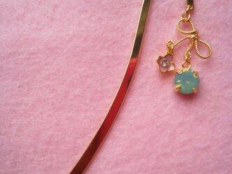 リボンとピンクのお花と小さいスワロのブックマーカーの画像