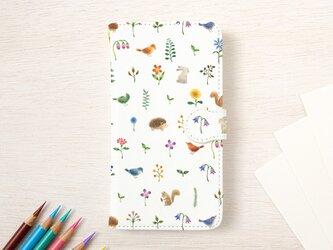 """絵本のかけら。手帳型スマホケース """"色とりどりの花と動物たち"""" TSC-92の画像"""