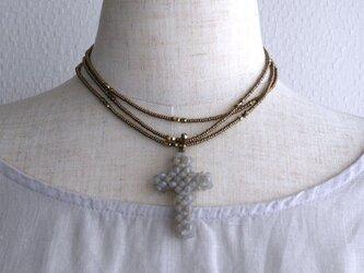 スワロフスキークロスのロングネックレスの画像