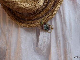 ラフィアブローチ~花くるまの画像