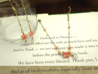 ピンク色の珊瑚 pierce&braceletの画像