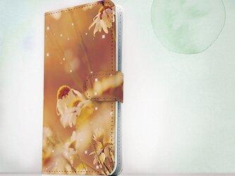 全機種対応 手帳型 スマホケース iPhoneXs iPhone9 iPhoneXs MaxiPhoneX 花柄 逆光の花畑の画像