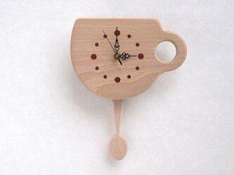 カップとスプーンの振子時計の画像