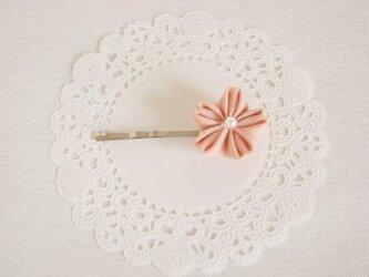 ピンクの可愛い桜モチーフのヘアピンの画像
