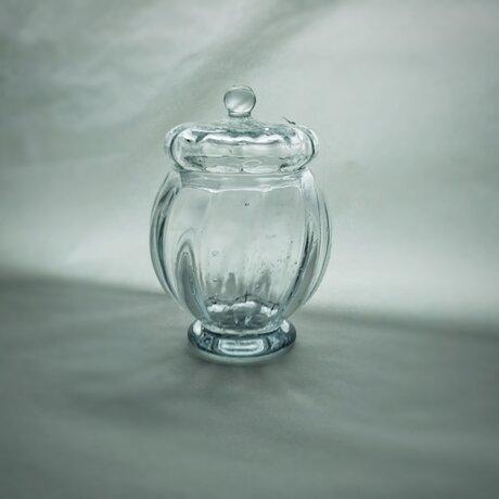 ブリキ色のガラスキャニスターの画像