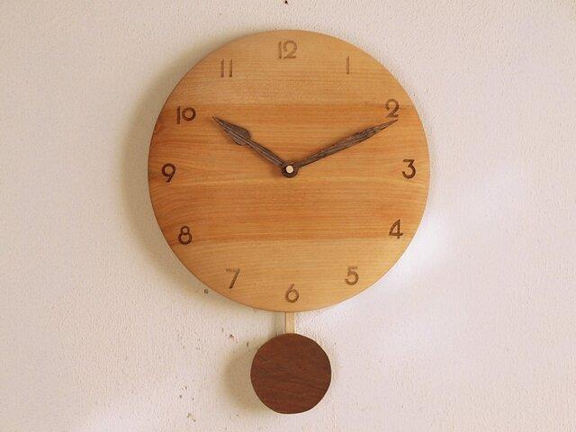 「はるまさまご注文の品」振り子時計 カバ材の画像1枚目
