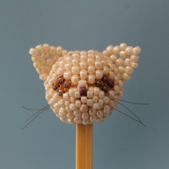 にゃんこヘッドの耳かき~ベージュ猫の画像1枚目